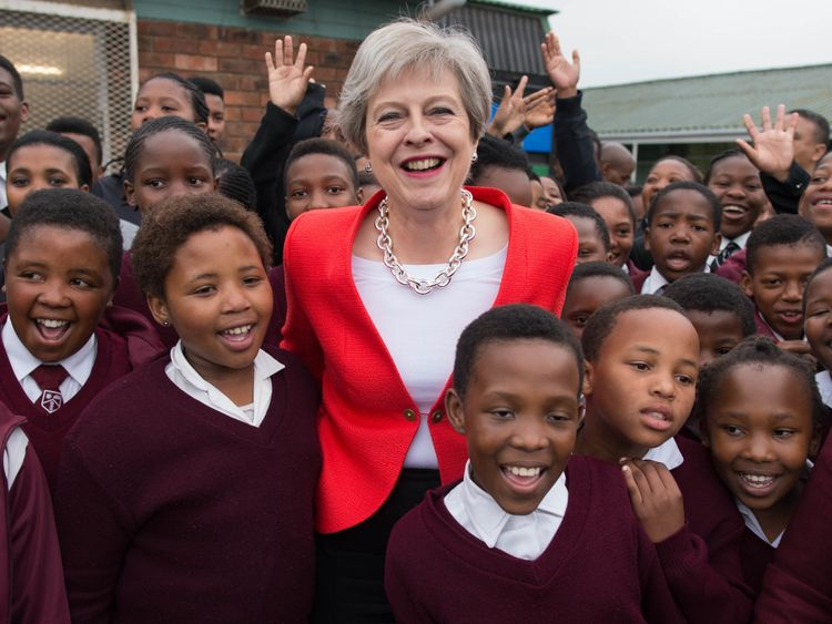 Prime Minister Theresa May meets students and staff at I.D. Mkize Secondary School in Cape Town