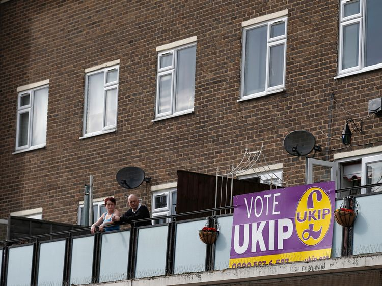 Onlookers watch the activity below them as Nigel Farage of UKIP visits the constituency of Thurrock in Essex, during an election campaign visit to the area,