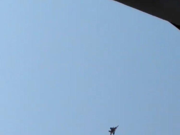 An F-15 jet flies overhead as it attempts to intercept a Horizon Air Bombardier Dash 8 Q400