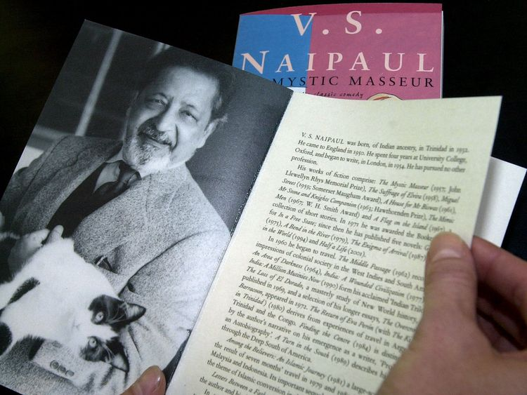 "A person displays a book with the title ""Mystic masseur"" written by V.S. Naipaul at the Frankfurt book fair October 11, 2001."