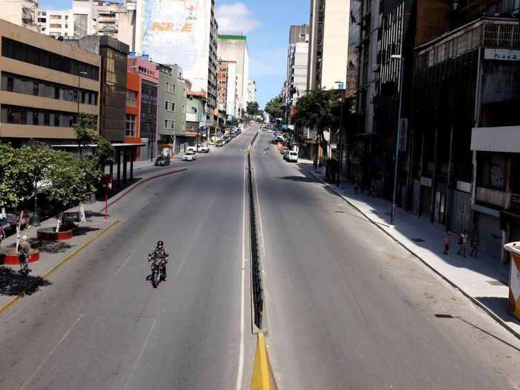 The streets were empty in Caracas on Monday as shops were closed because of the new currency