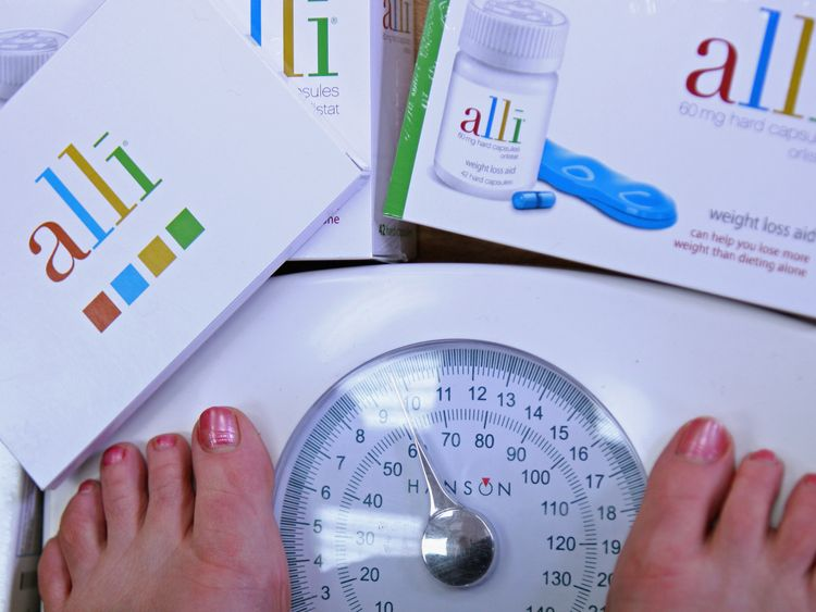 In this photo illustration a G W Allan chemists stocks the Alli slimming pill on April 23, 2009 in Edinburgh, Scotland. The slimming pill now available over the counter claims to cause 50 percent more weight loss when taken with every meal.