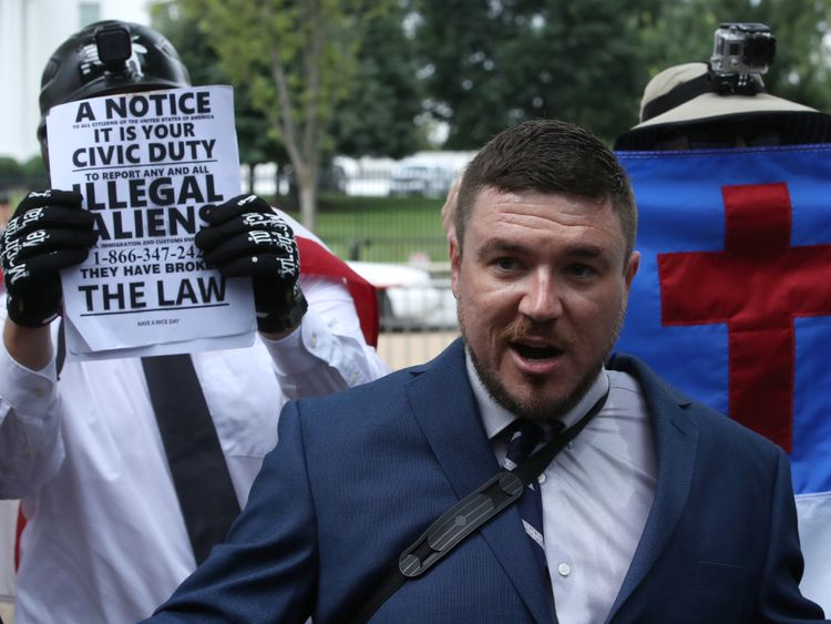 Surrounded by his supporters, Jason Kessler (C) sets off for his white supremacist 'Unite the Right' rally