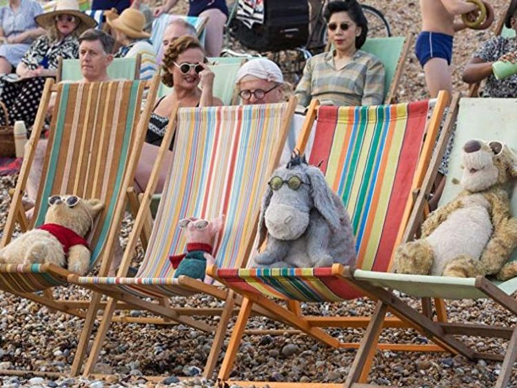 Pooh Piglet Eeyore and Tigger catch some rays on the beach