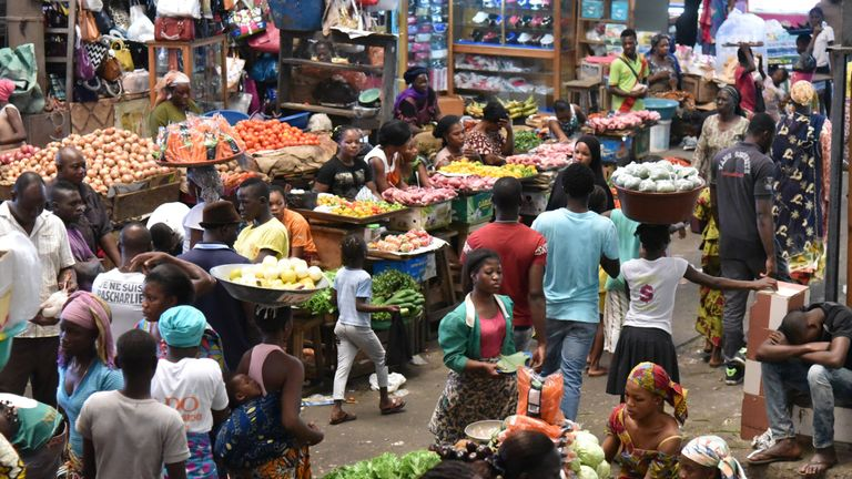 People shop at a market in Abidjan on October 28, 2015. AFP PHOTO / SIA KAMBOU (Photo credit should read SIA KAMBOU/AFP/Getty Images)