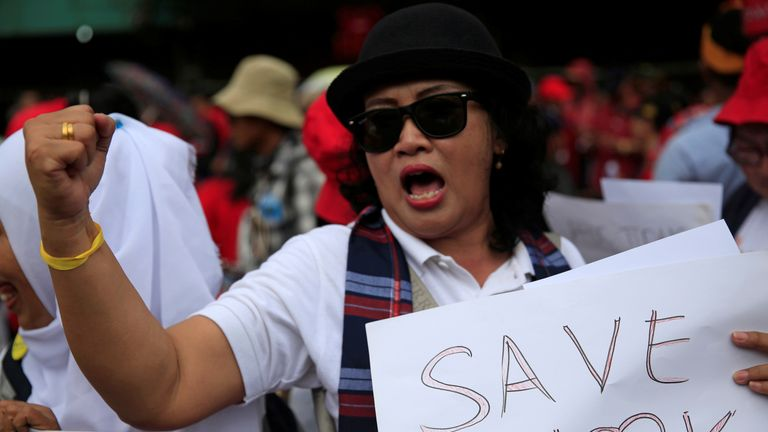 A protester campaigns to Save Ahok from a guilty verdict for blasphemy