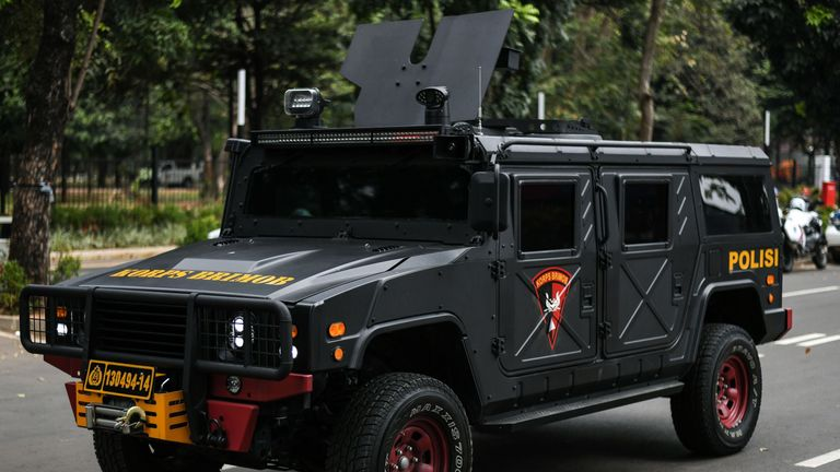 A police vehicle  patrols the streets in the build-up to the games
