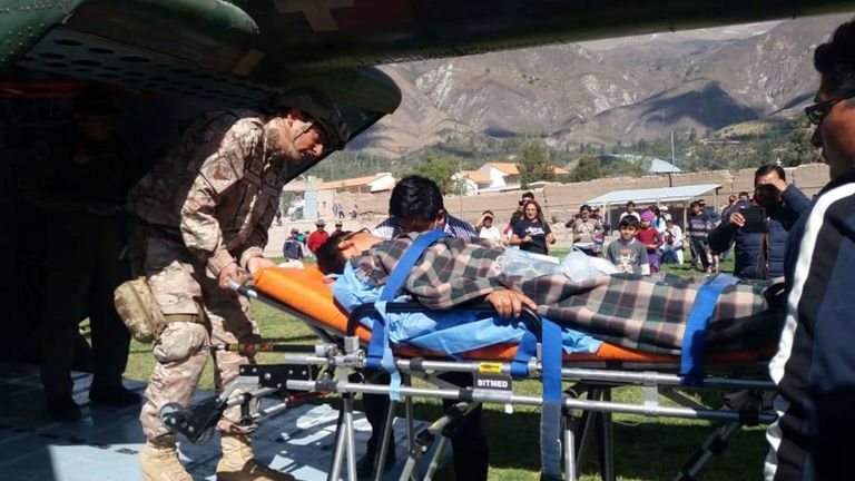 A person is transported to a helicopter after eating contaminated food at a funeral in the Peruvian Andes, authorities said on Tuesday, in Ayacucho, Peru, in this undated photo released August 7, 2018