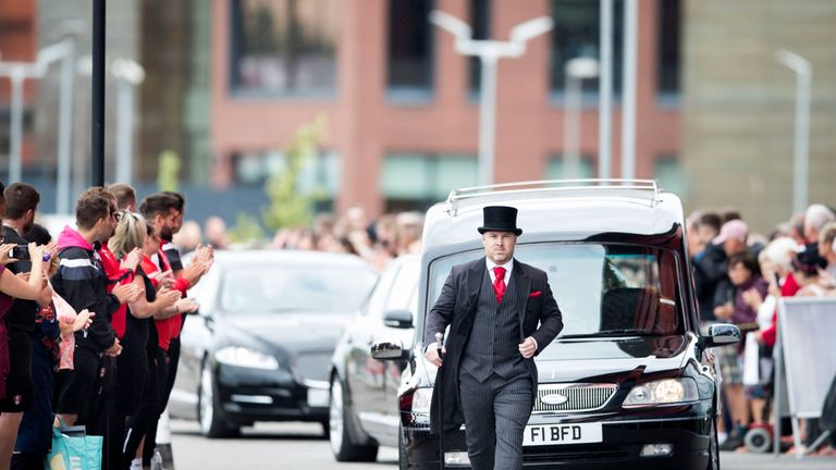 The cortege carrying the coffin of Barry Chuckle arrives at the New York Stadium, Rotherham, for his funeral