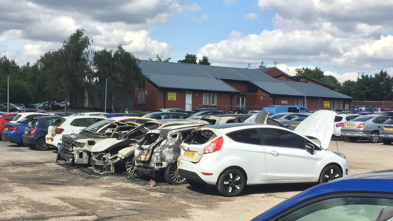 Burned out vehicles in the car park of Birmingham prison