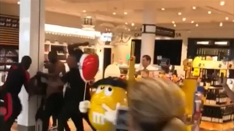 French rappers Booba and Kaaris and their minders swung punches and lashed out with kicks and crashed through cosmetics stands in a duty-free shop