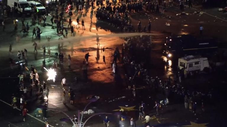 Water cannon is used to disperse protesters in Bucharest