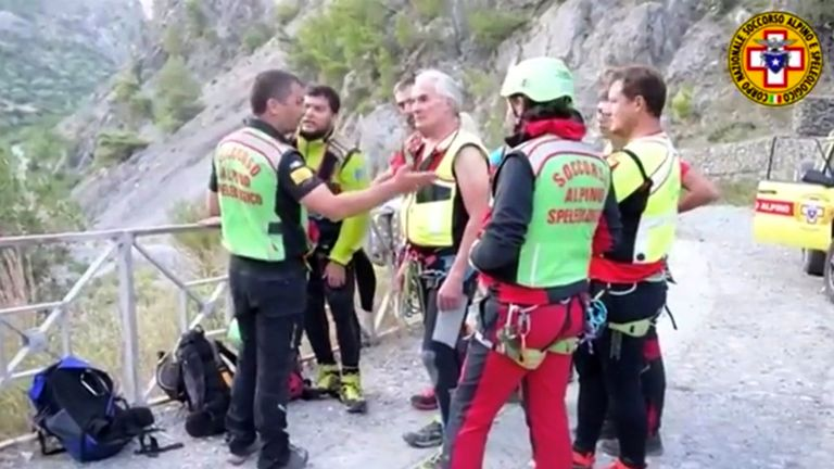 Rescue teams stand by to enter the Raganello Gorge after 11 were killed in flash flooding