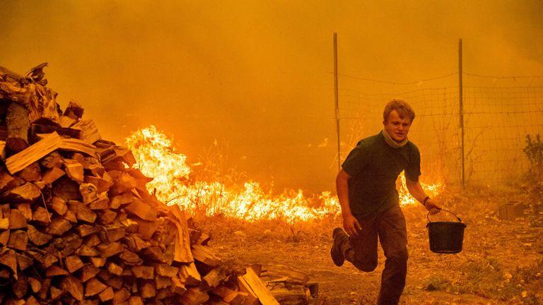 Alex Schenck battles to save his home near Clearlake Oaks, California