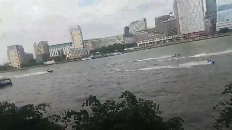 Police could be seen chasing the jetskis past Canary Wharf into central London. Pic: Kristina Kuznetsova