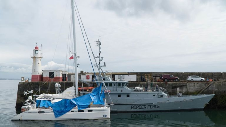 The catamaran, flanked by a Border Force vessel