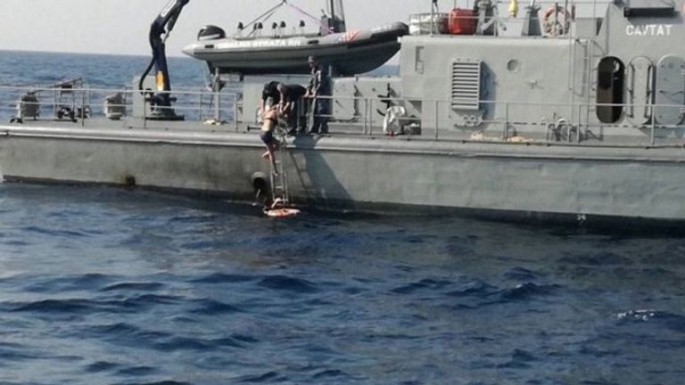 The woman can be seen boarding a rescue ship in he Adriatic Sea on Sunday
