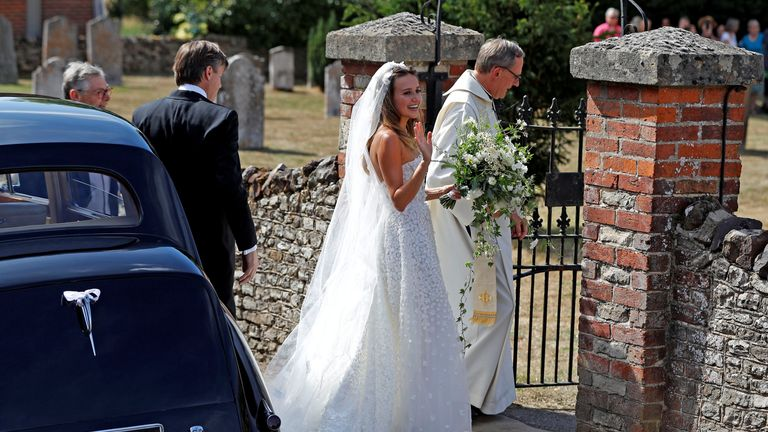 Bride Daisy Jenks arrives at the church for her wedding to Charlie van Straubenzee