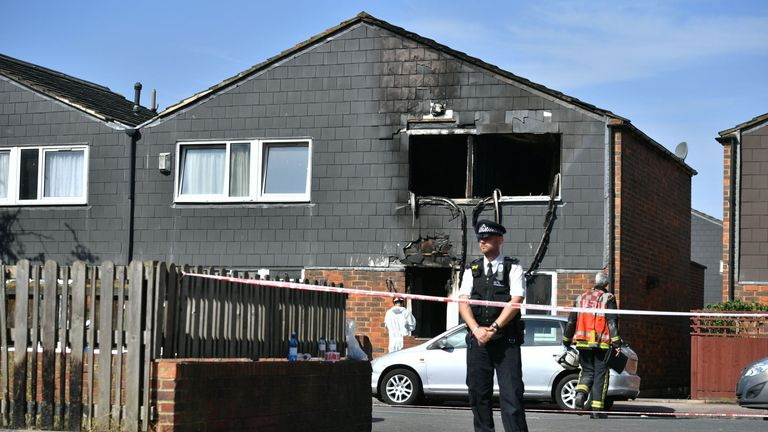 A police officer at the scene of a house fire on Adolphus Street, Deptford