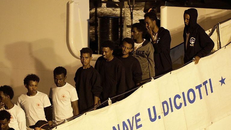 Migrants are allowed to disembark the Diciotti coast guard ship after 10 days