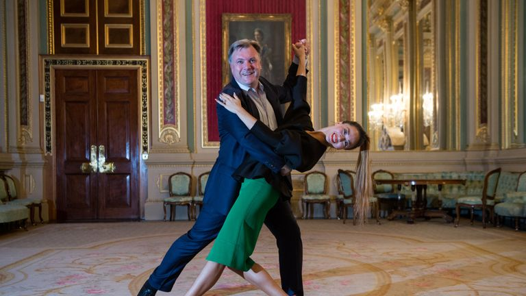 LONDON, ENGLAND - OCTOBER 05: Former Economic Secretary to the Treasury Ed Balls and his dance partner Katya Jones from BBC dance programme Strictly Come Dancing, pose for photographs in a room at Draper's Hall during the Room to Read's Annual Wine Gala on October 5, 2016 in London, England. Room to Read is a non-profit organization for improving literacy and gender equality in education in the developing world. The Annual Wine Gala serves as a charity fundraising event including an auction. (Ph