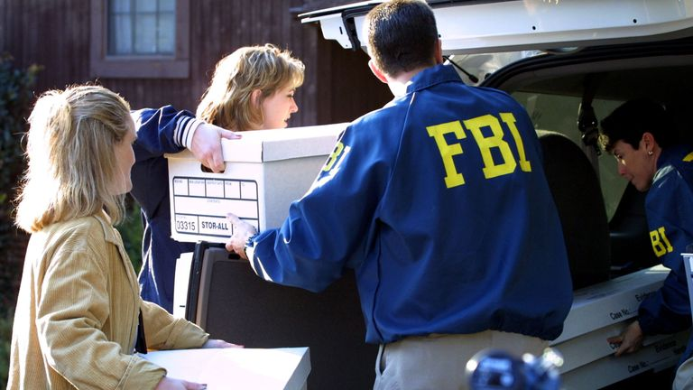 385823 05: FBI agents remove evidence from the home of FBI agent Robert Philip Hanssen February 20, 2001 in Vienna, Va. Veteran FBI agent Robert Philip Hanssen has been charged with spying for Moscow for more than 15 years. He was arrested after allegedly dropping off a package of classified information for Russian agents. (Photo by Alex Wong/Newsmakers)