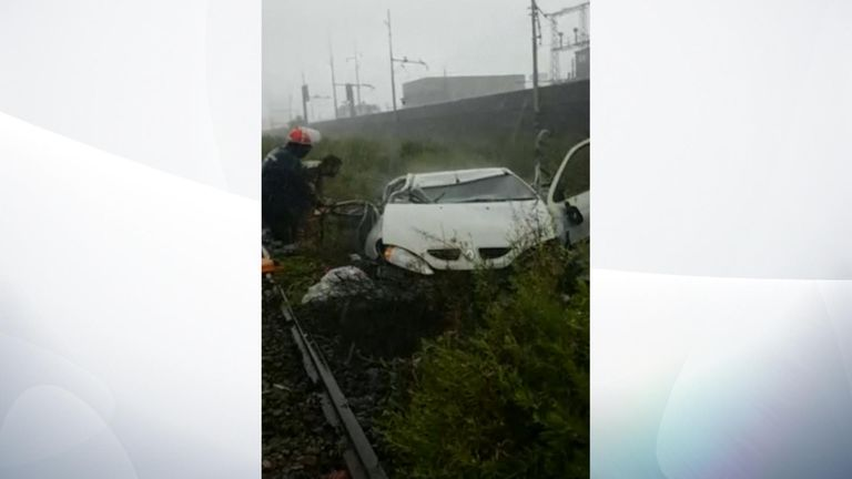 A car lies wrecked after the bridge collapsed