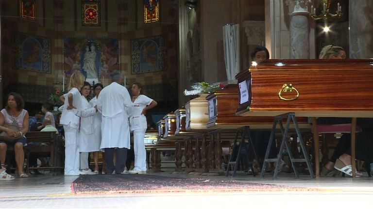 Coffins of the victims are lying in one of the city's churches