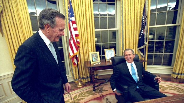 George HW Bush (L) and his son George W Bush in 2001