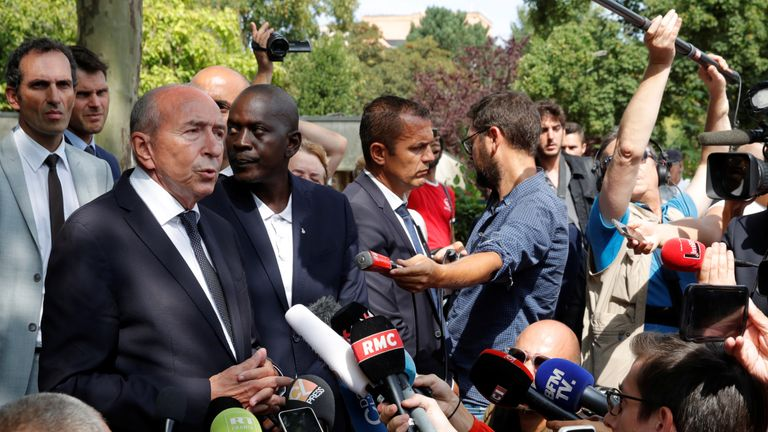 French Interior Minister Gerard Collomb speaks to journalists near the scene