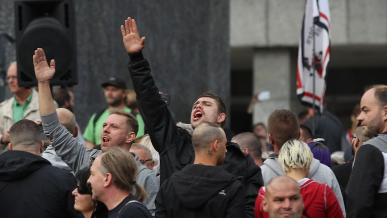 CHEMNITZ, GERMANY - AUGUST 27: A man raises his arm in a Heil Hitler salute towards heckling leftists at a right-wing protest gathering the day after a man was stabbed and died of his injuries on August 27, 2018 in Chemnitz, Germany.