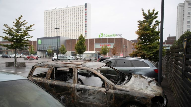 Burned cars are pictured at Frolunda Square in Gothenburg, Sweden