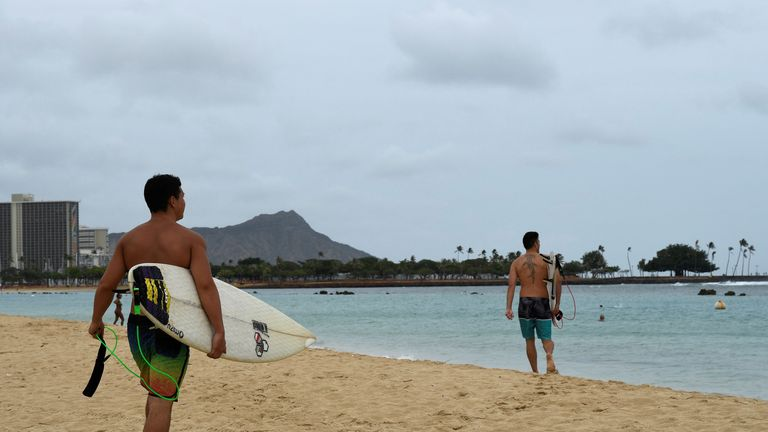 Surfers walk to the water to paddle out as Hurricane Lane approaches Honolulu, Hawaii, U.S. August 23, 2018. REUTERS/Hugh Gentry