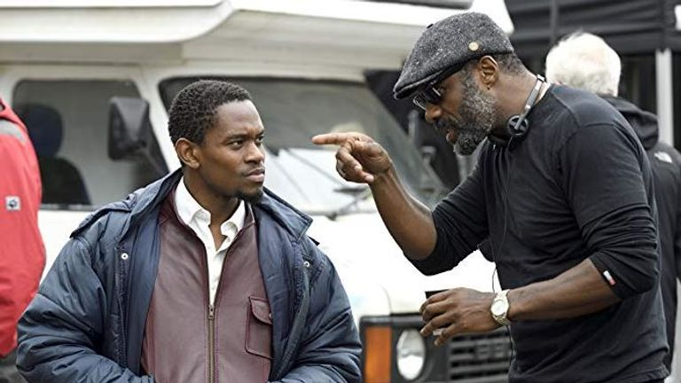 Elba directs Aml Ameen, who plays the star, Dennis Campbell