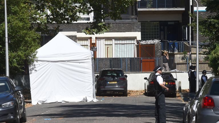 Police guard a forensic tent on Warham Street