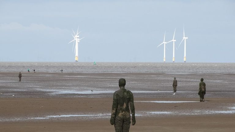 The iron men line two miles of the Liverpool coastline. Pic: Geograph
