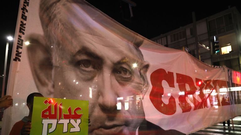The 'Crime Minister' banner was also seen at a protest in Tel Aviv on Saturday