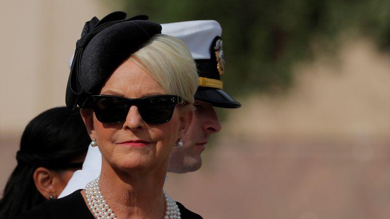 Cindy McCain, John McCain's widow, waits outside the church
