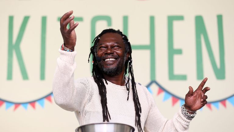 Levi Roots performs during a cooking demonstration at the Big Feastival held on the farm of Blur bassist Alex James' at Kingham in the Cotswalds.