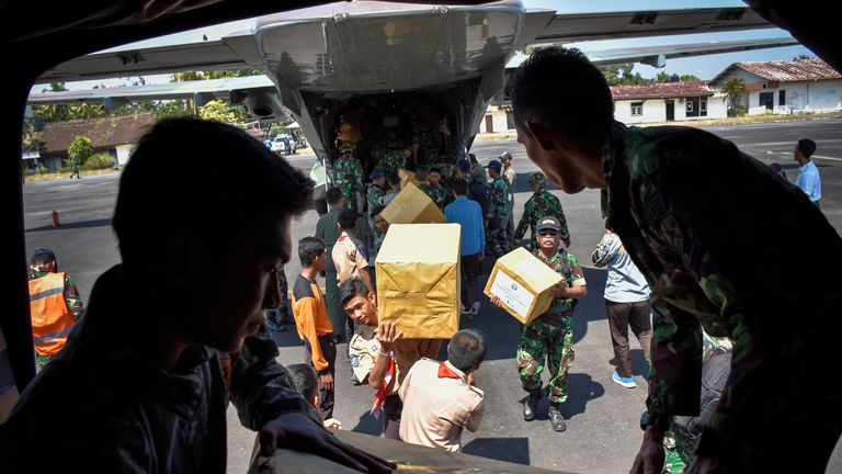 Soldiers unload relief aid at the Mataram airbase on Lombok