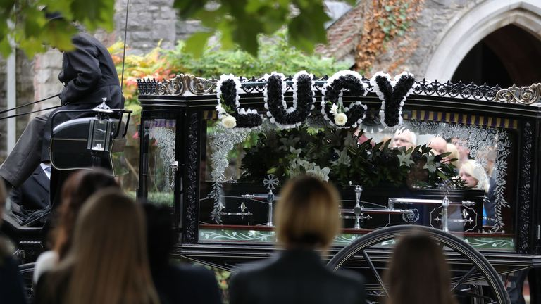 A horse-drawn hearse carrying the coffin of 13-year-old Lucy McHugh after her funeral ceremony at Hollybrook cemetery in Shirley, Southampton.
