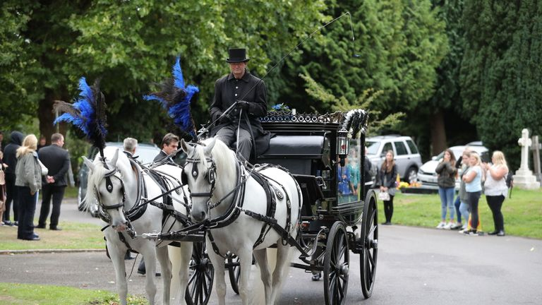A horse-drawn hearse carrying the coffin of 13-year-old Lucy McHugh arrives ahead of her funeral at Hollybrook cemetery in Shirley, Southampton.