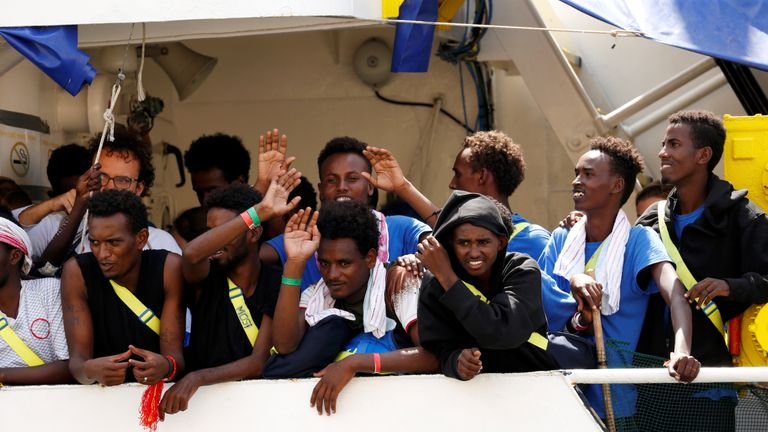 Migrants wave as Aquarius docks at Boiler Wharf in Senglea, in Valletta's Grand Harbour, Malta