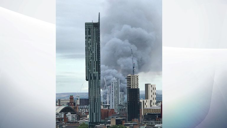 The smoke is billowing across the Manchester skyline