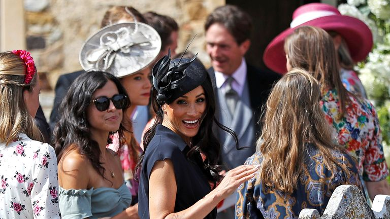 Meghan Markle attends a society wedding in Surrey
