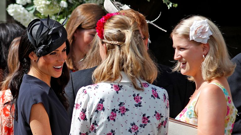 Meghan chats to guests at the wedding of Charlie van Straubenzee and Daisy Jenks