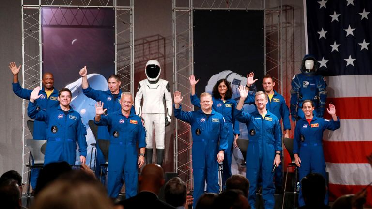 The astronauts assigned to crew the first flight tests and missions of the Boeing CST-100 Starliner and SpaceX Crew Dragon