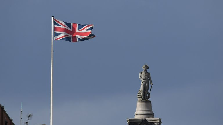 A Union flag flaps in the wind on a building near to Nelson's Column in Trafalgar Square, in central London on March 28, 2017. British Prime Minister Theresa May will send a letter to EU President Donald Tusk with Britain's formal departure notification on Wednesday, opening up a two-year negotiating window before Britain actually leaves the bloc in 2019. / AFP PHOTO / Justin TALLIS (Photo credit should read JUSTIN TALLIS/AFP/Getty Images)