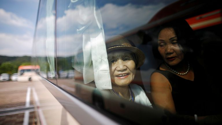 A South Korean participant for a reunion sits inside a bus as she arrives at the venue