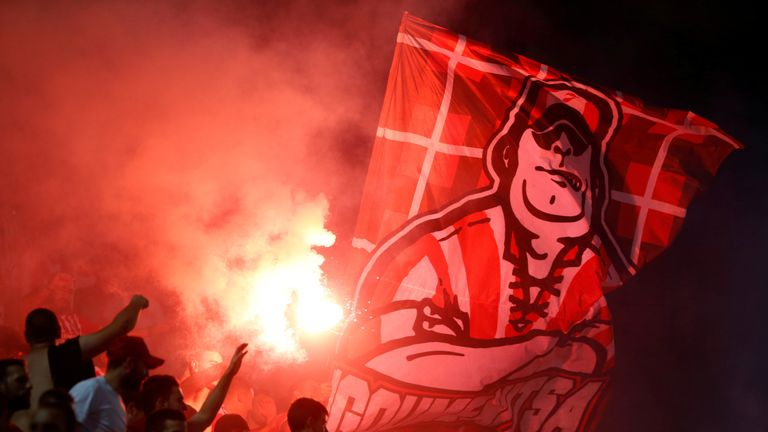 Olympiacos fans let off a flare